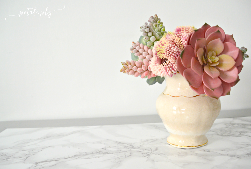 wm-pink-succulents-on-marble-table