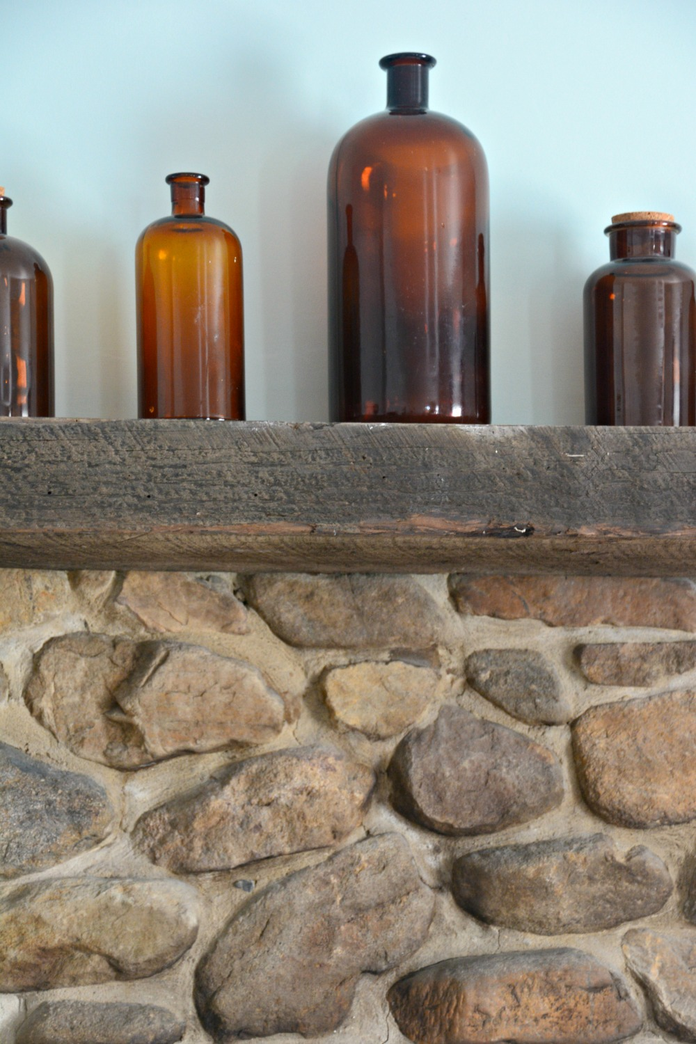 brown-glass-bottles-on-mantle