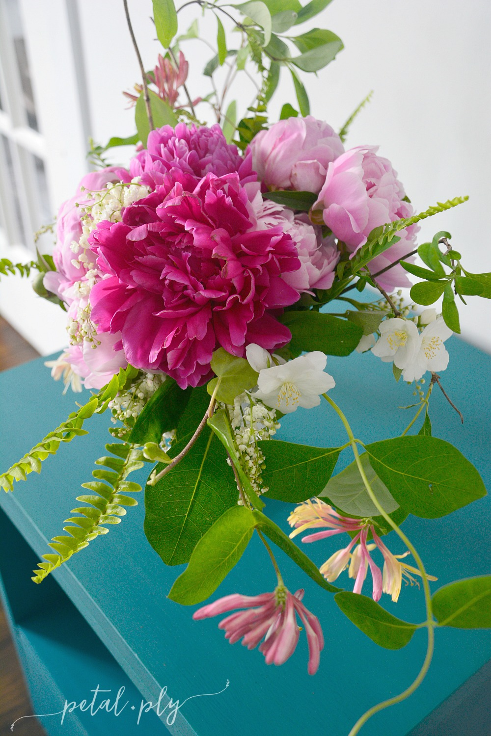 Asymmetrical garden flower arrangement for Garden arrangement