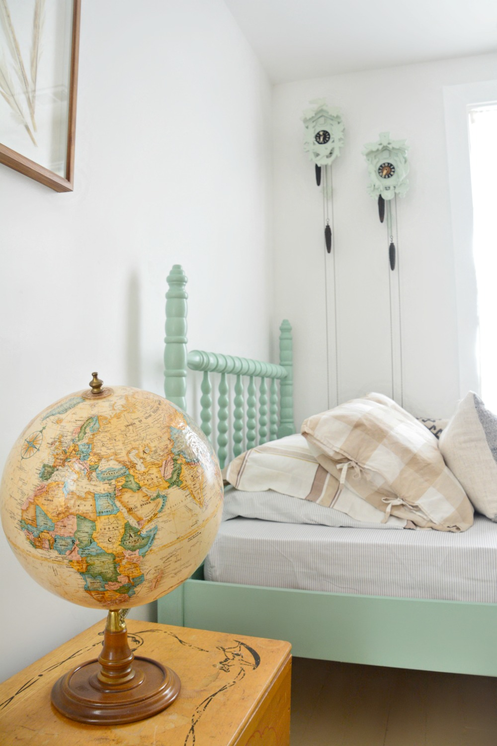 neutral-globe-and-painted-cuckoo-clocks